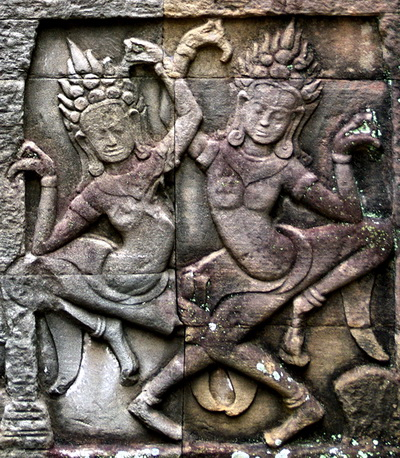 These Bayon dancers are seen on a bas-relief with musical accompaniment. They are not dancing on lotus flowers and may represent real women.