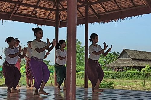 Psychological Healing From Cambodian Dance Arts: NKFC students practice 6 days per week, in open air pavilions and no electricity. Music is provided by cassette players powered by car batteries.