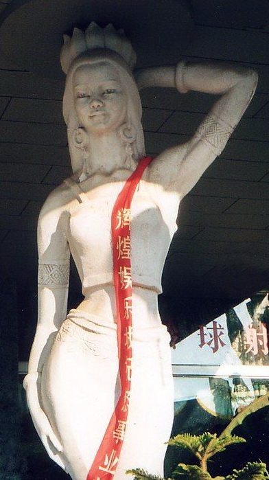 This goddess greets visitors arriving to Xishuanbanna's Jinhong Airport. Her attributes relate to Khmer families discovered living in Southern China.
