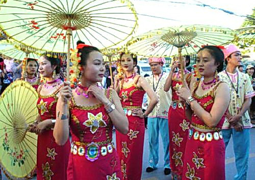Colorfully dressed Pi-Nong Dai women at a festival.