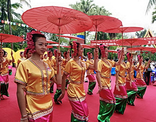 Umbrellas, a sign of royalty throughout Southeast Asia and India, are featured in Xishuanbanna dances and festivals.