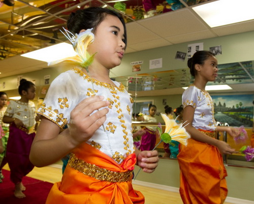 Khmer Classical Dance students in traditional costumes study with the Cambodian Association of Greater Philadelphia dance project