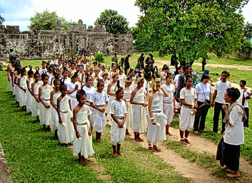 62 barefoot dancers gather at Preah Vihear temple on the tense Cambodian-Thai border to perform a sacred ritual for peace led by Ravynn Karet-Coxen (right).