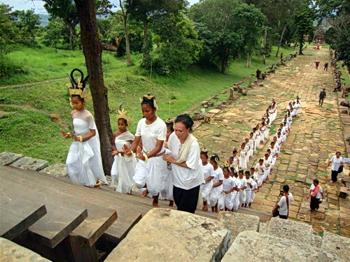 Sacred dancers ascending Preah Vihear temple with offerings of peace.
