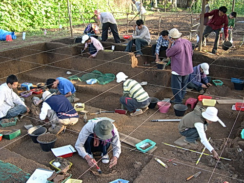 Archaeologists and students work together on an excavation in Memot, Cambodia.