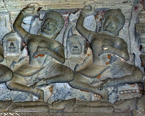 Two Tantric yogini dance upon corpses in a ritual at a Khmer temple in Pimai, Thailand.