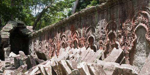 Each alcove originally held the Mahayana trinity in relief, but religious conflict caused them to be removed later.