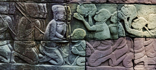 Banteay Chhmar protects thousands of square meters of historical carvings, like this scene showing traitors executed during a rebellion.