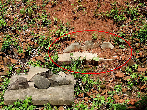 The two Koh Ker pedestals as Warrack found them at Prasat Chen in May 2007. The pedestal circled in red shows a fabric section still attached in the center.