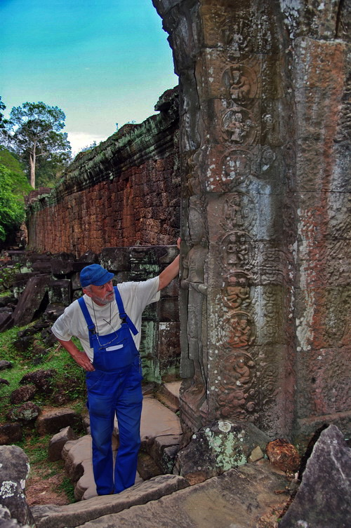 Renowned photographer Jaro Poncar ponders the mystery door at Preah Khan. To see his extraordinary images of Angkor visit www.poncar.de