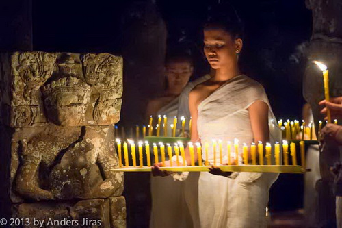The NKFC Sacred Dancers of Angkor troupe performing a blessing ritual at Bayon temple in Angkor Thom. February 2013. Photo by Anders Jiras.