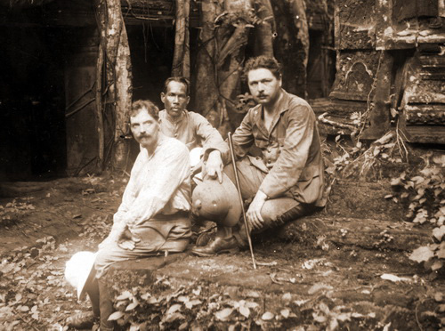 Henri Marchal, a Cambodian guide and George Groslier at Ta Prohm temple in Angkor, 1910.